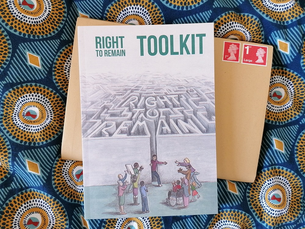 copy of the Right to Remain Toolkit book on top of a stamped envelope