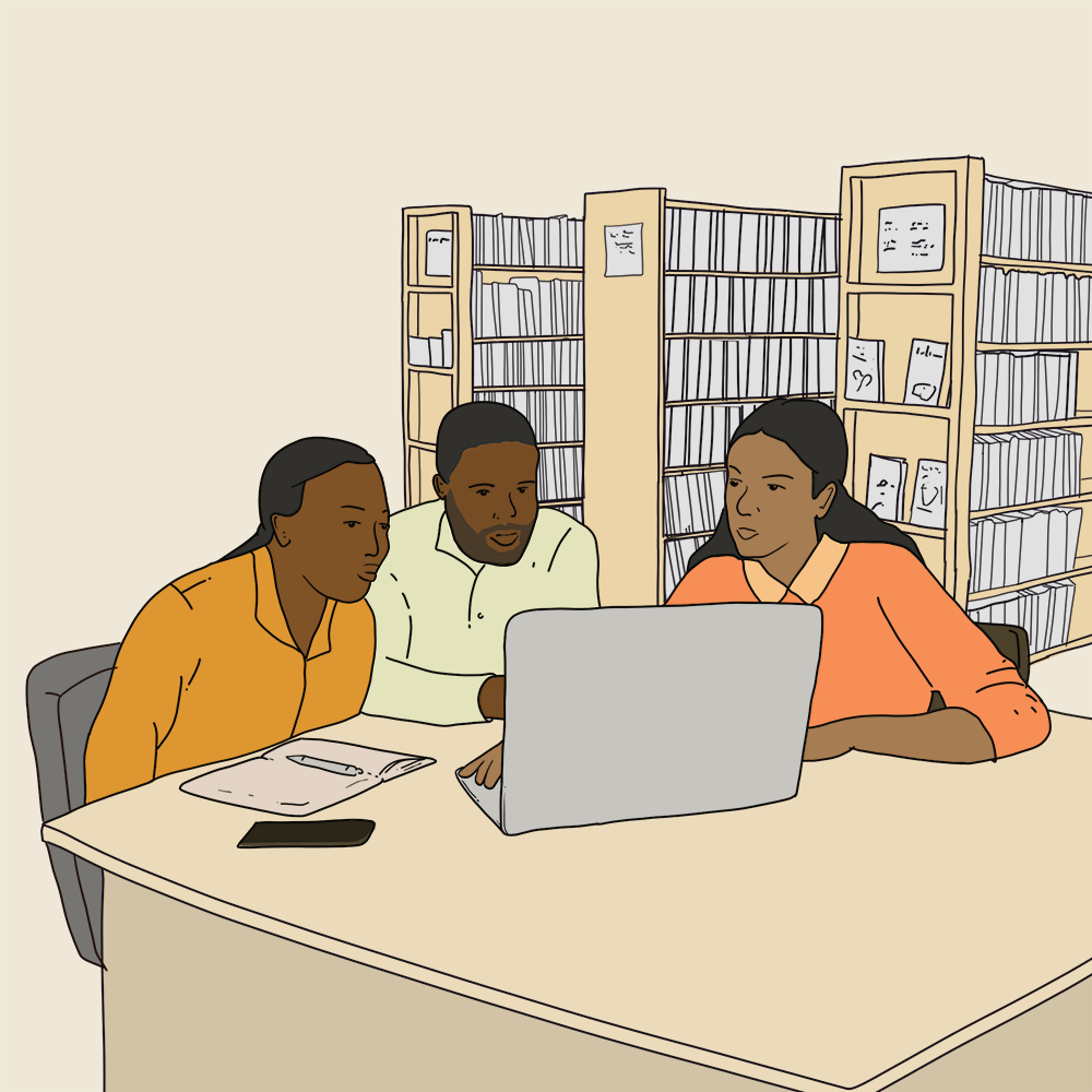 three people sitting together looking at a laptop. background is library shelves