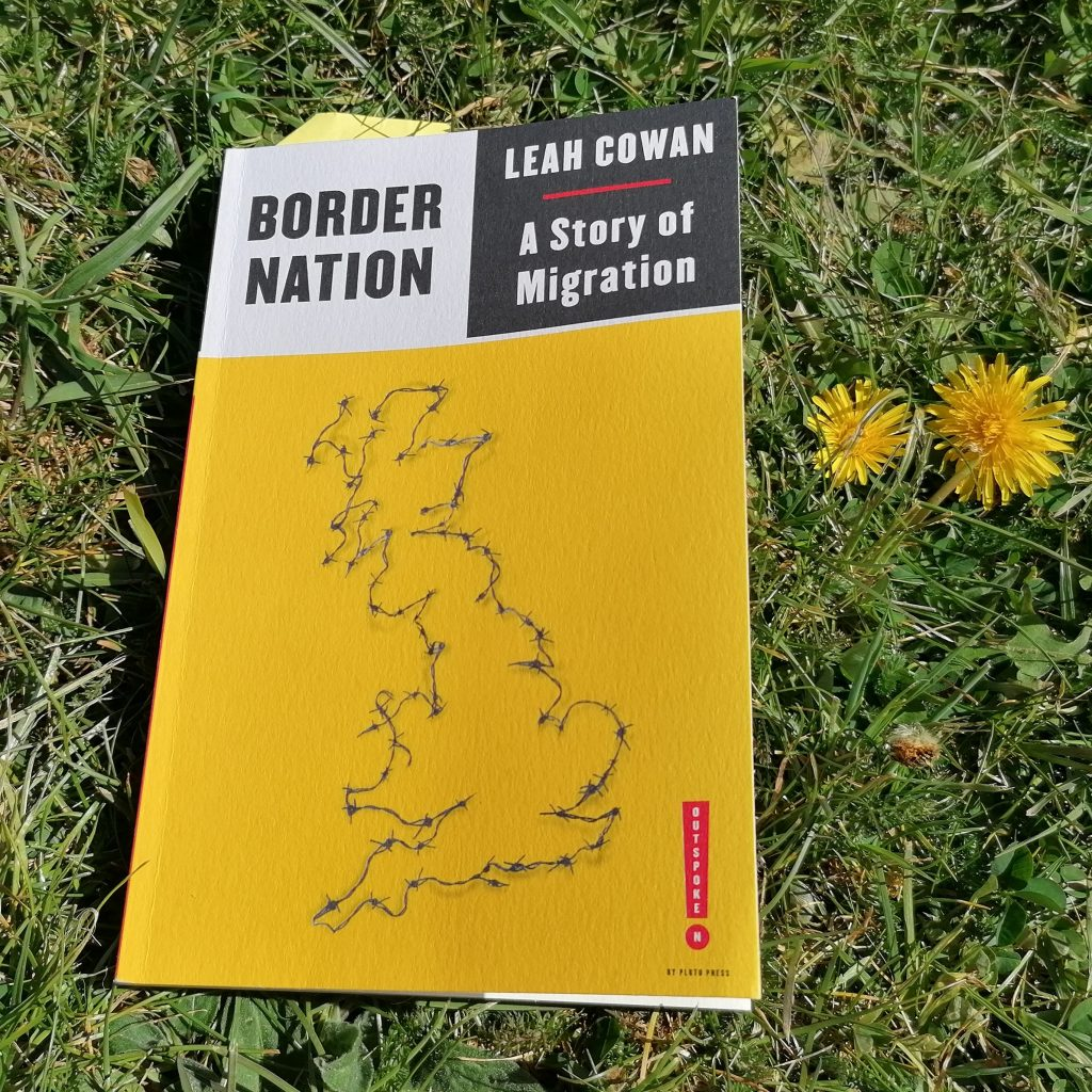 A copy of Border Nation lying on the grass